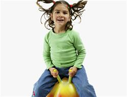 Girl on spacehopper Image
